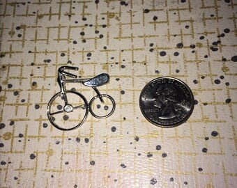 Silver vintage tricycle brooch