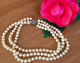Three strand pearl choker with metal clasp circa 1960s