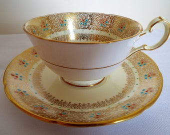 Vintage Royal Grafton Teacup. Yellow, Gold and White Tea Cup and Saucer With Hand Painted Flowers. A Rare and Beautiful Tea For One Gift
