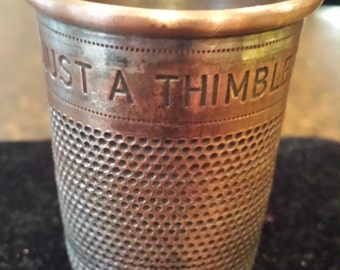 "Vintage ""Just a Thimblefull"" bar measure"