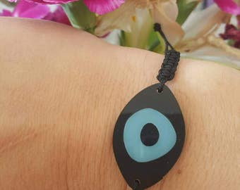 evil eye macrame bracelet, black and blue acrylic eye, black cord