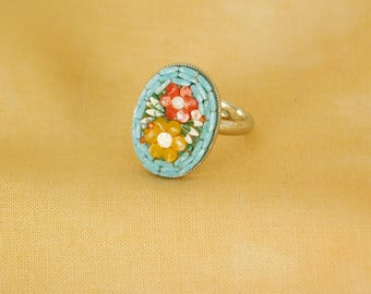 Micro mosaic ring - flowers - light blue background