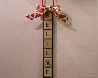 BELIEVE scrabble tile Christmas ornament on green ribbon with a bow