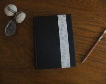 Black flowers book silver