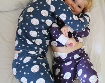 Kids pyjamas with moons and stars, available in blue and purple, organic cotton jersey knit, sizes 0-5/6