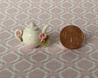 Miniature teapot with roses on handle and mouthpiece and painted dots