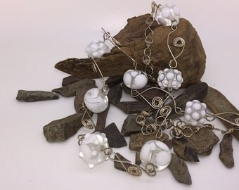 Wirework necklace with white glass pearls
