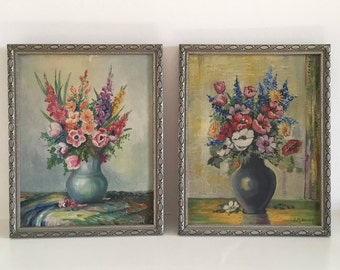 Pair of framed floral still life oil paintings on canvas C.1930's, signed by the artist, vintage flowers.