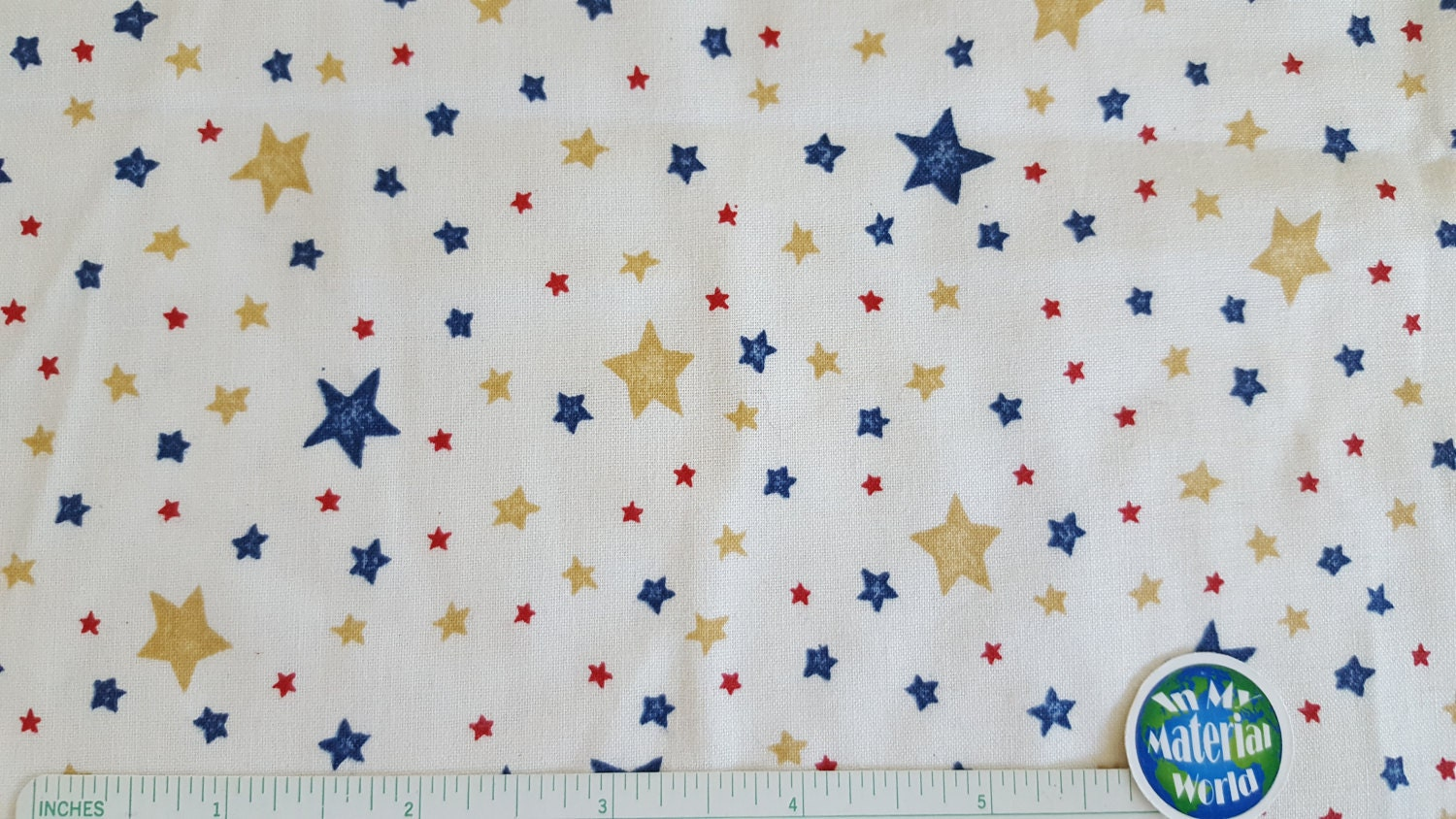 Star fabric navy red tan stars on off white marcus for Star fabric australia