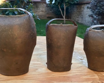 Vintage/primitive French forged cowbells with bone clappers - rusty and weathered - made in France