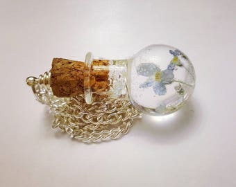 Jar with forget-me-nots
