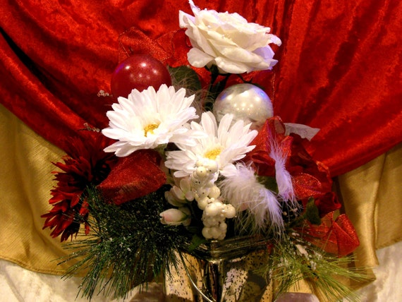 Christmas Fabulosity Red & White Centerpiece  features Heavily Beaded White Tea Rose w Pearls Showcase with Poppies in Mercury Glass Base