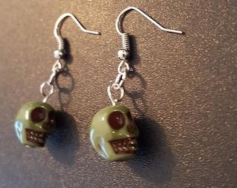 Green acrylic skull beaded drop dangle earrings with silver detail