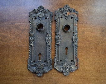 vintage pair of iron door plates with oxidization / antique matching escutcheon pair with oxidization