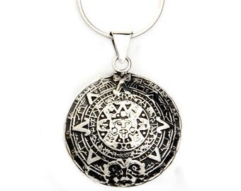 Aztec Calendar with silver necklace