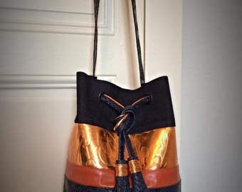 Marine and copper bucket bag bright with PomPoms