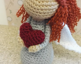 Weighted crochet red haired angel.