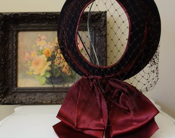 Vintage 1950s brown wool hat with veil and bow detail