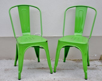 2 garden chairs made of metal stacking chairs green design classic by Xavier Pauchard
