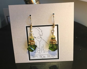 Dangly Green and Gold Swarovski cube earrings.