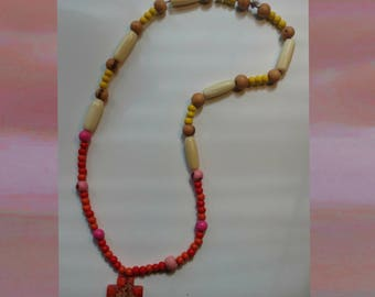 Beaded necklace with red cross pendant