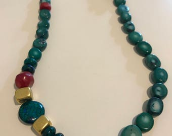A green and turquoise necklace with a touch of red and gold