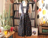 vintage 1980s overall apron dress, pinafore jumper - black with rainbow polka dots . womens medium large APPROX