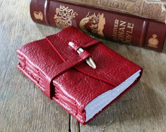 Leather Journal . scarlet red pebble-grain leather with natural shell peg . handmade handbound (320 pgs)