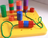 Discovery Toys Giant Pegboard toddler stacking and lacing toy.