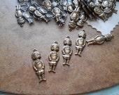 59 pc brass buster brown charm - destash jewelry supplies