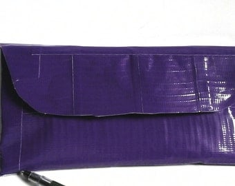 purple duct  tape wall with pink stripe inside . also comes with a matching pen