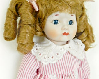 Vintage Porcelain Doll / 14 inches tall