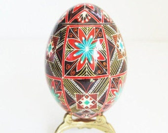 Turquoise and red Pysanka ornament stunner pattern done in fine tip kistka tool for batik i love this ornament such a pretty gift idea