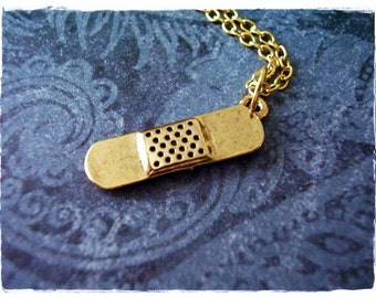 Gold Bandage Necklace - Antique Gold Pewter Bandage Charm on a Delicate Gold Plated Cable Chain or Charm Only