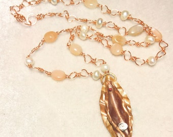 Peach Moonstone and Pearl Moon Flower necklace featuring copper metalwork feminine flower vulva art pendant on copper wire petal chain