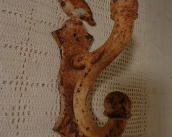 Vintage Chippy Cast Iron Double Wall Hook with a Bird