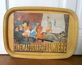 French tray. Metal serving tray with French Lumber cinema decoration