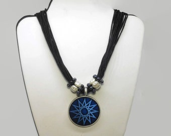 Blue star pendant, round blue epoxy and pewter pendant, faux translucent seed pearl ringlets, multi-strand black cord, star or sun