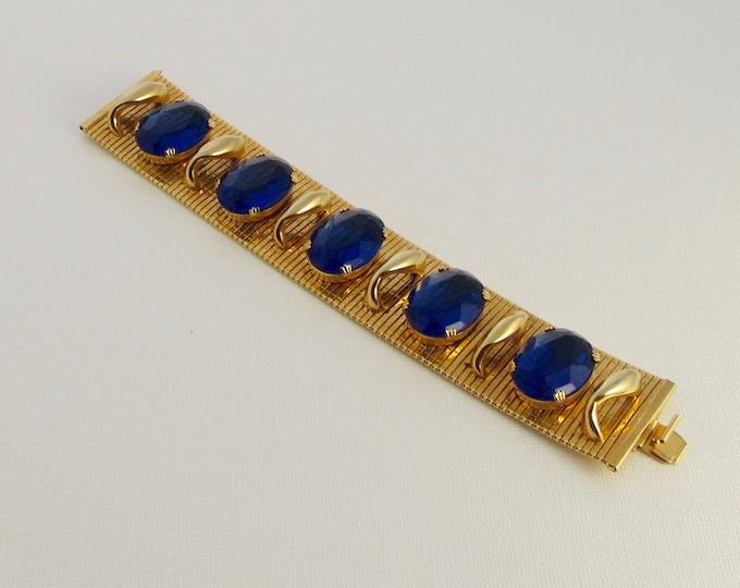 Fun and Fabulous Gold Tone Blue Glass Bracelet; Wide Gold Tone Bracelet; Flexible Gold Tone Bracelet; Wide Bracelet with Blue Glass