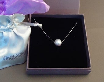 Silver necklace with a floating grey freshwater pearl
