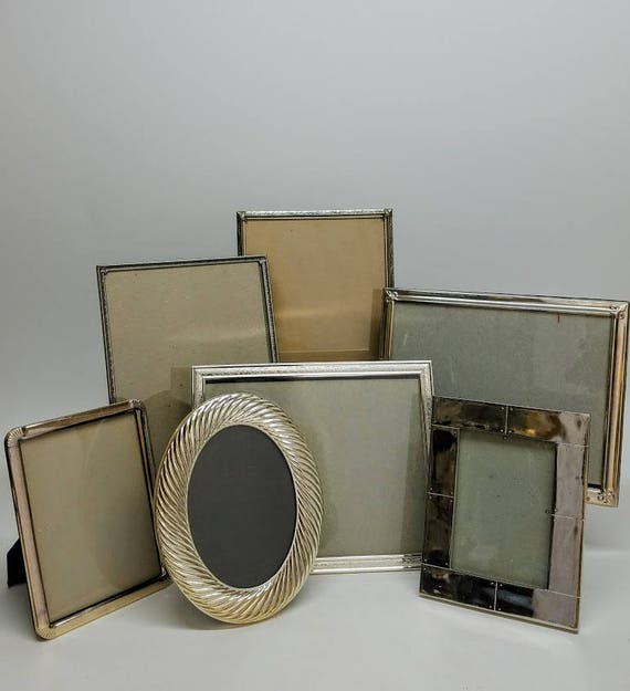 Collection Of Picture Frames Silver Tone Set Of 7 Various Designs Sizes Of Frames With Glass & Easel Stand