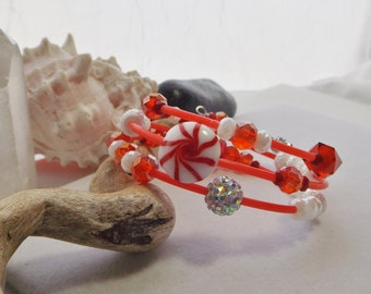 Red and White Holiday, Winter, Christmas, Adjustable Small Oval Memory Wire Bracelet with Red Rubber Tubing, Glass, Resin, Acrylic Beads