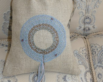 A linen bag for gift with handmade bobbin lace