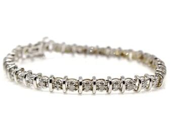 14k White gold diamond bracelet single strand