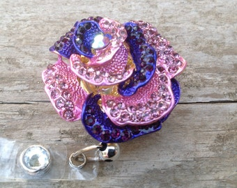 Purple and pink rhinestone flower badge reel