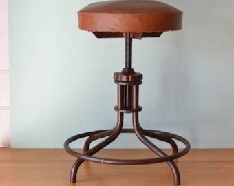 Vintage industrial adjustable swivel stool utilitarian