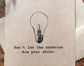 "Funny greeting card: ""don't let the a**holes dim your shine"""