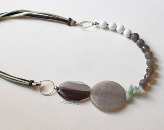 Necklace with three leather straps and big different stones, grey, white, purple, green