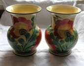 Pair of 1930s Hand Painted Cream Czechoslovakian Pottery Vases with Bright Red  Green Floral Pattern and Black Edging  SLIGHT DAMAGE