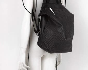 Black perforated leather backpack